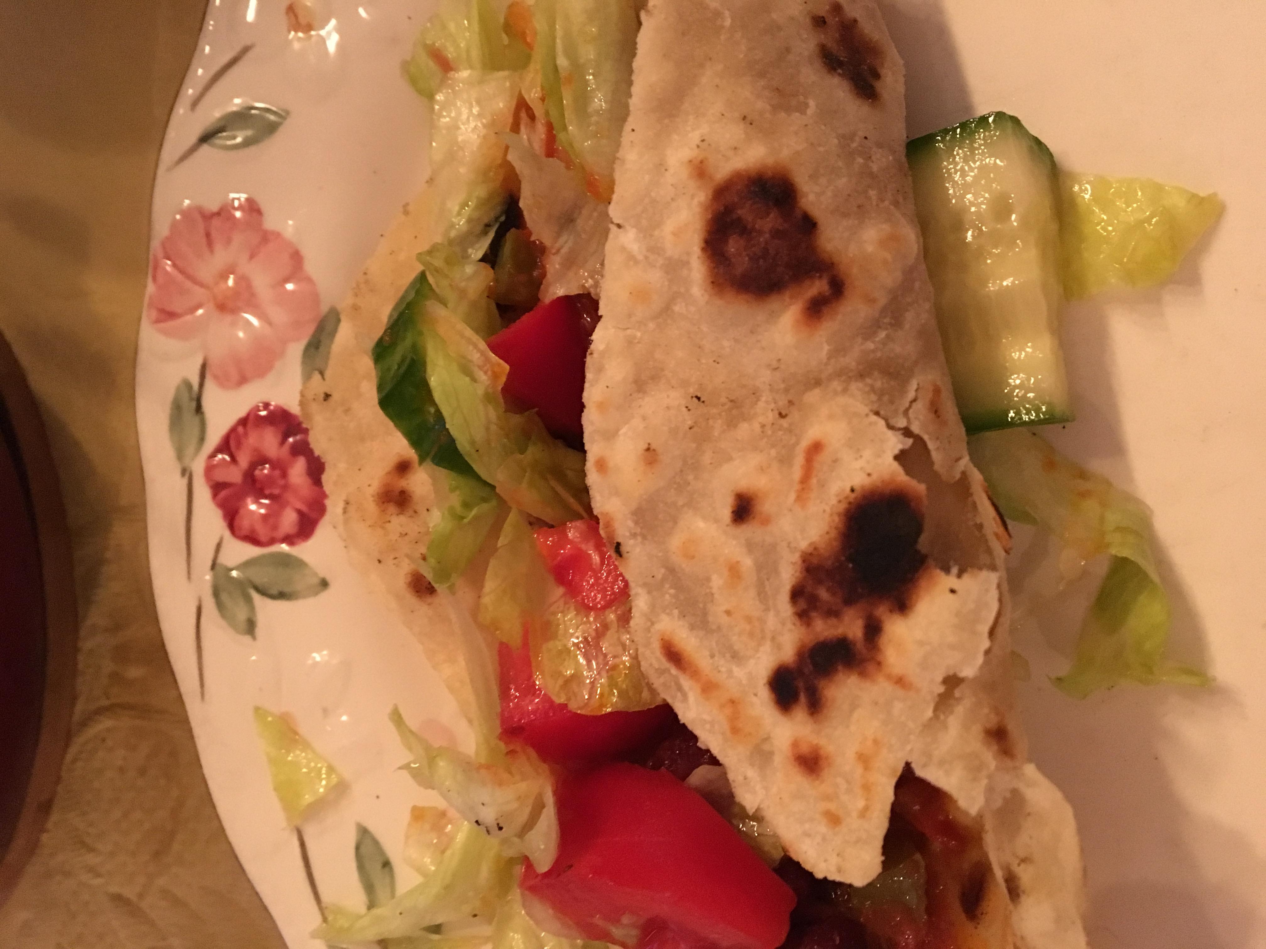 Home made tortillas encase Chili con beany